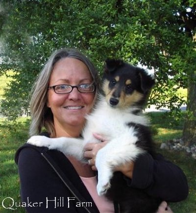 holding a Collie puppy